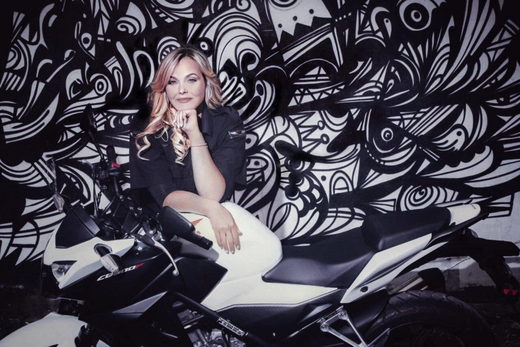 Ginny Allen Portrait with Honda CBR 300 motorcycle